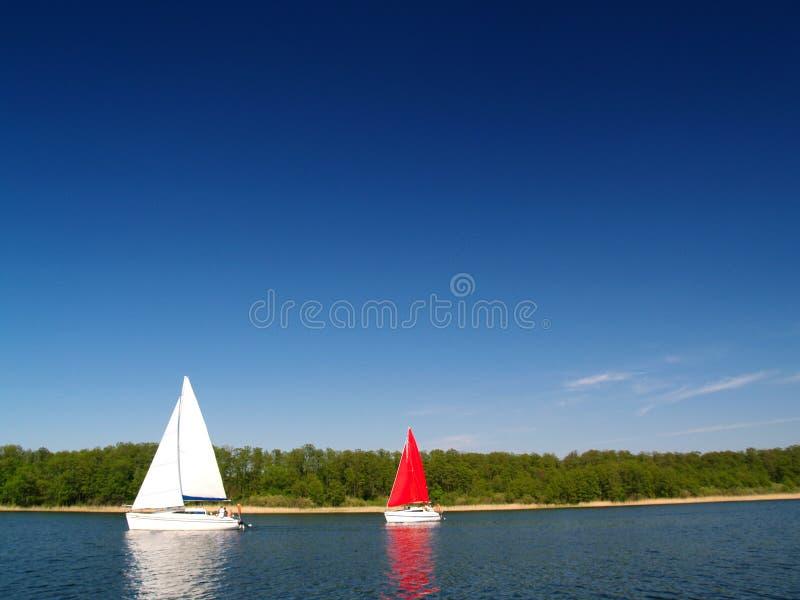 Sailing yachts on lake royalty free stock photo