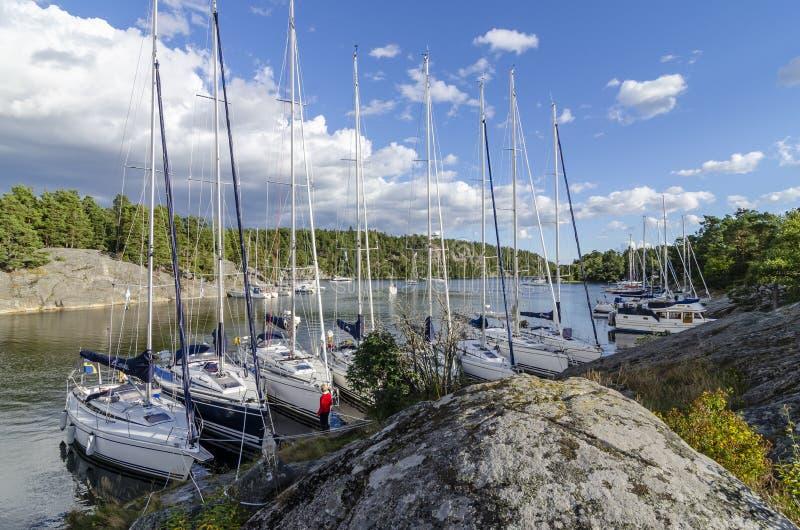 Sailingboats anchored Napoleonviken Stockholm archipelago stock photography
