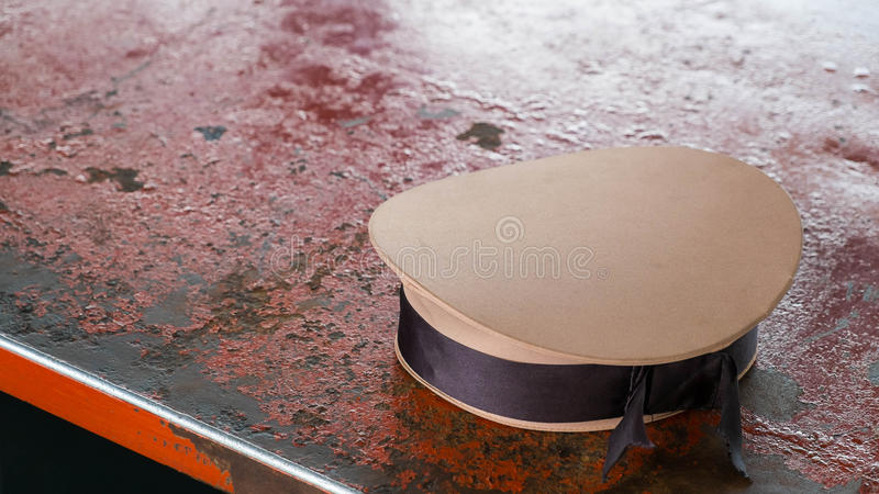 Sailor hat on table. Uniform of sailor royalty free stock photos