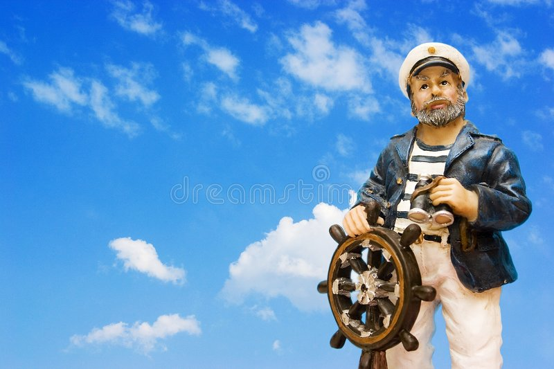 Sailor at the helm stock photo