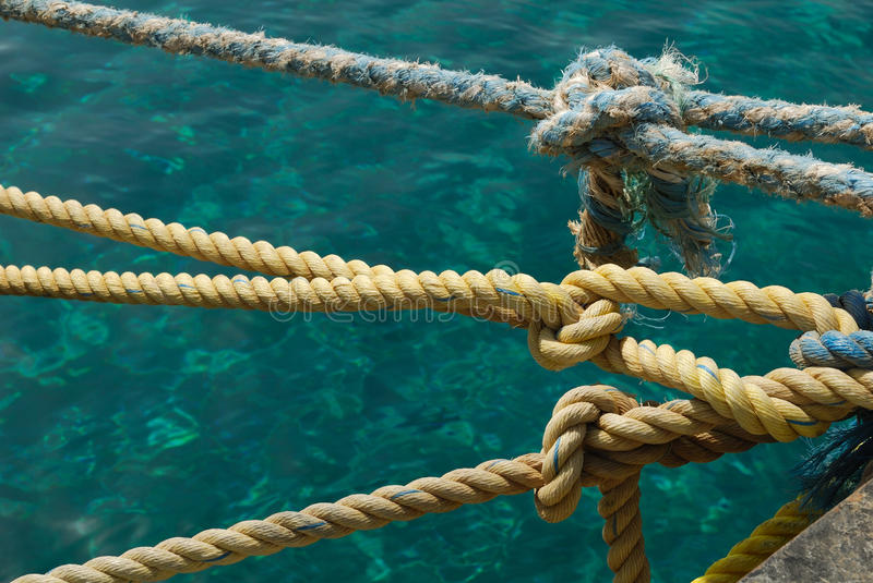 Sailor knots. On sea water background royalty free stock image