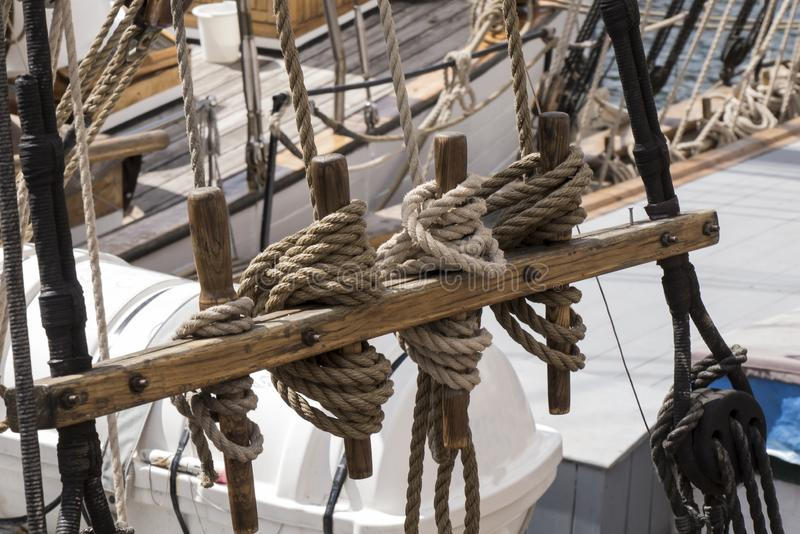 Sailor knots mooring a ship docked at the dock royalty free stock images