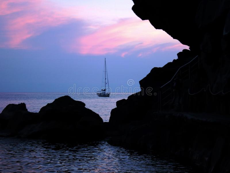 Sailor`s Delight_3. Beautiful time of day to capture silhouettes on the oceanside. Liguria CinqueTerre is paradise on earth for those who love boating, canoeing stock images