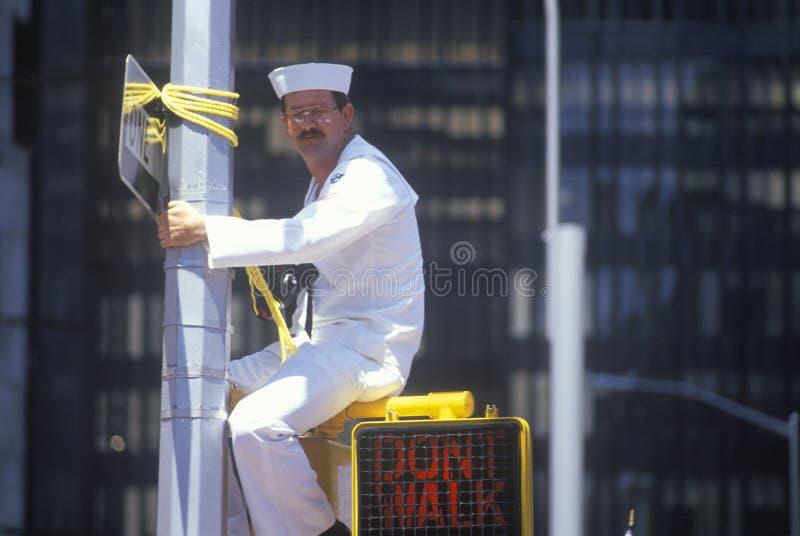 Sailor Sitting on Traffic Sign. New York City, New York royalty free stock photos