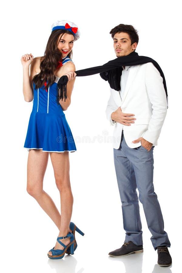 Sailor Woman Seducing Young Rich Man Royalty Free Stock Images