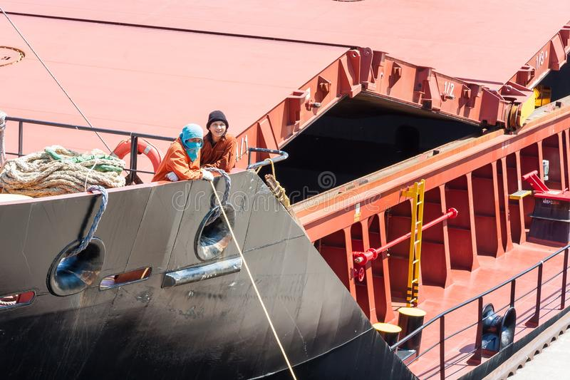 Sailors on Bow of Large Ship royalty free stock photography