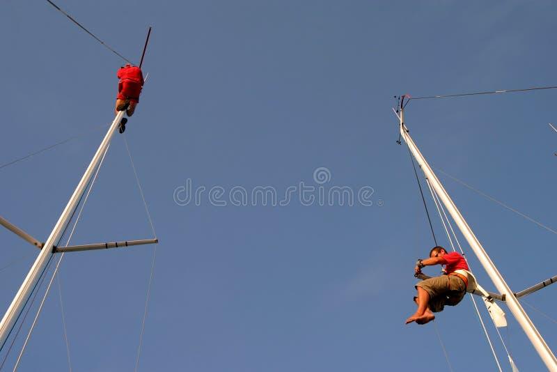 Sailors climbing mast royalty free stock image