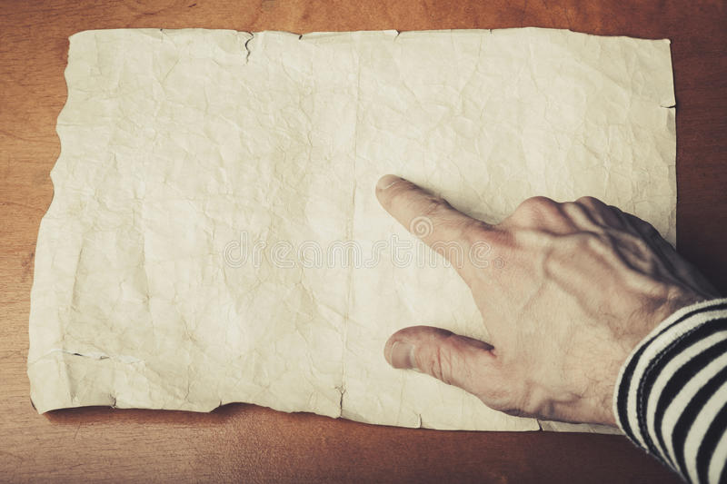 Sailors hand pointing some place on empty paper stock images