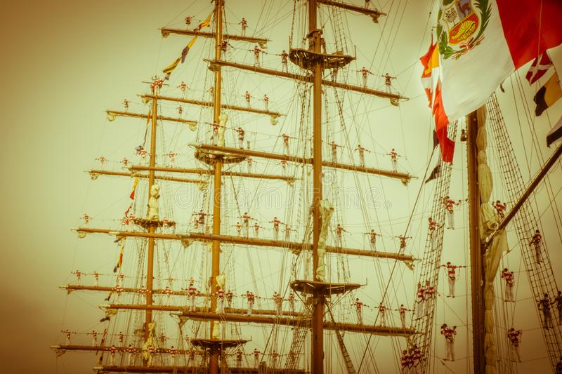 Sailors in masts for greet ship flag peru royalty free stock image
