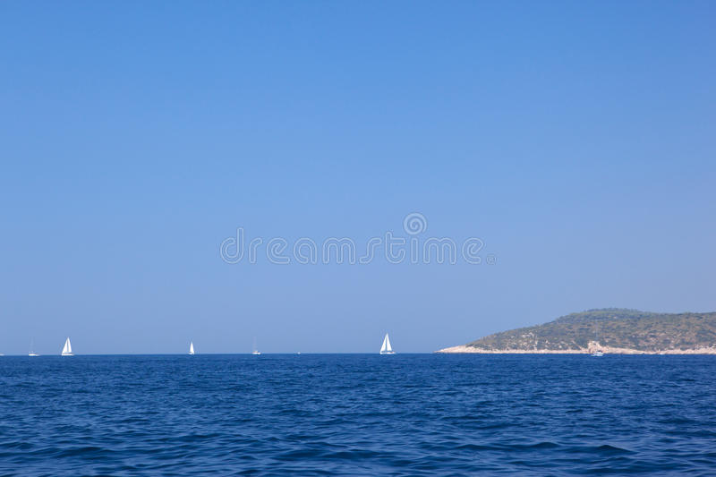 Download Sails on the horizon. stock photo. Image of clear, tranquil - 10470866