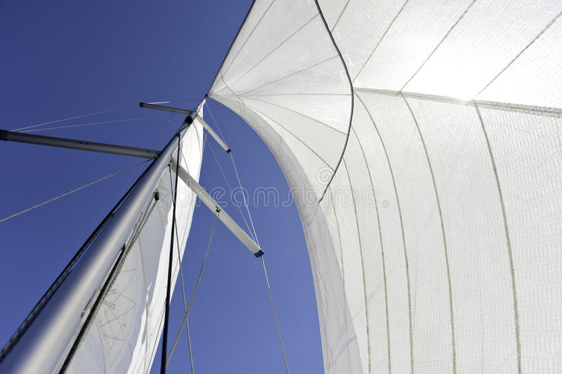 Sails and mast. Over blue sky background royalty free stock photography