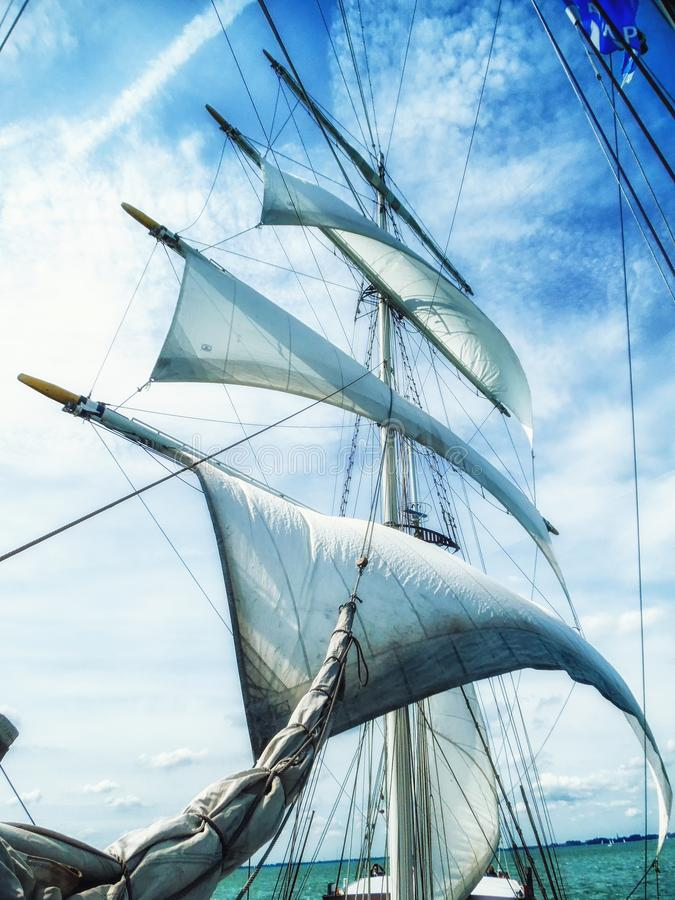 Sails, mast and ropes view from below of a classic sailingship. Sails, mast and ropes view from below of a classic sailing ship royalty free stock images