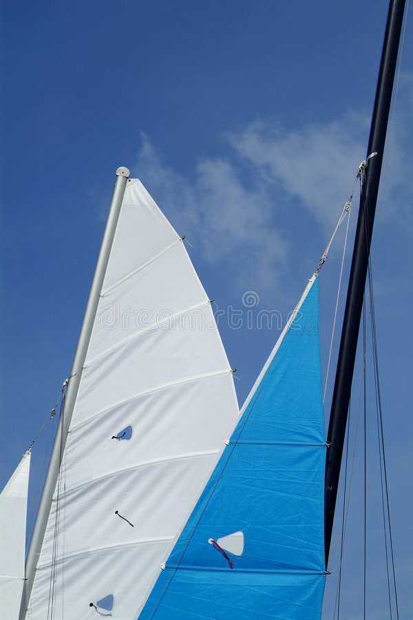 Sails of two catamarans royalty free stock photography