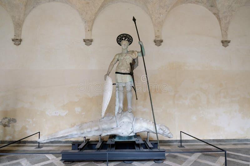 Sain西奥多雕象在共和国总督的宫殿庭院里在威尼斯,意大利 免版税库存图片