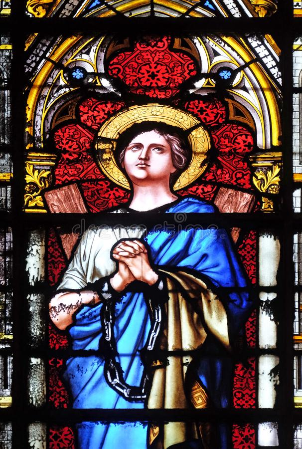 Saint Agatha of Sicily. Stained glass window in the Basilica of Saint Clotilde in Paris, France royalty free stock photo