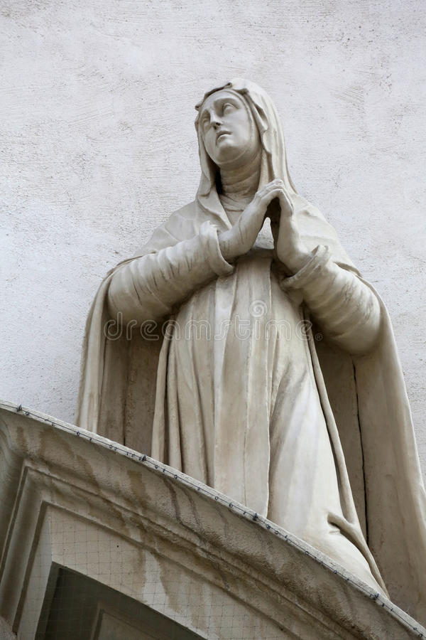 Saint Agnes of Montepulciano. On the facade of Dominican Church in Vienna, Austria. Famous baroque church was completed in 1634 stock photos