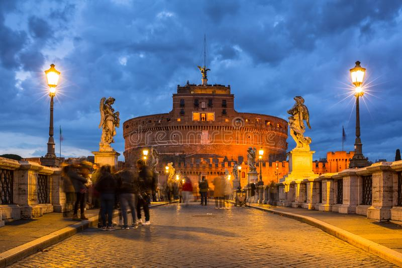 Saint Angel Castle over the Tiber river in Rome at dusk, Italy royalty free stock photos