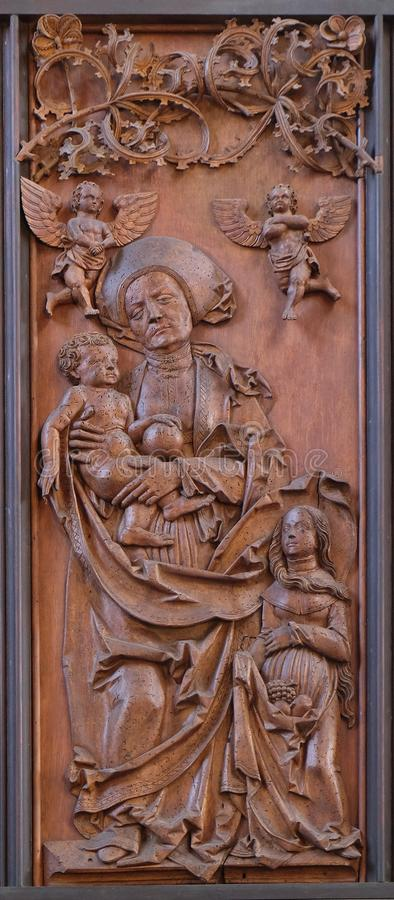 Saint Anne, Child and Virgin Mary, Coronation of Mary altar in St James Church in Rothenburg ob der Tauber, Germany stock images