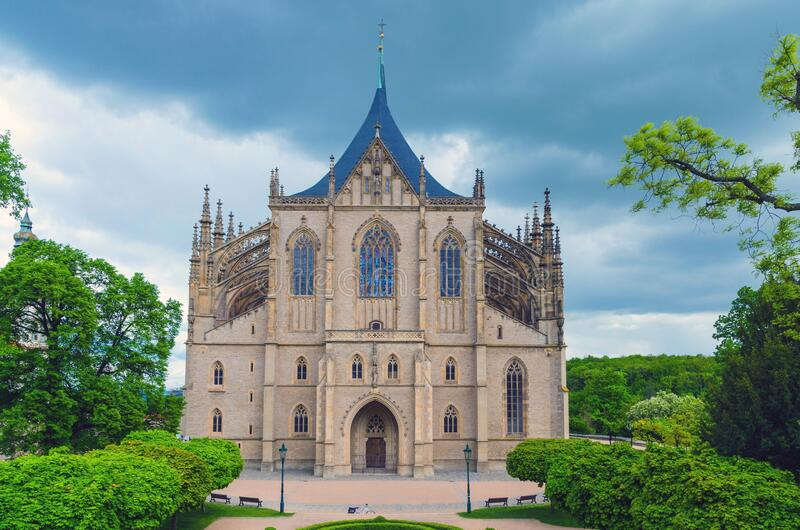 Saint Barbara Church Cathedral of St Barbara Roman Catholic church Gothic style building facade in Kutna Hora. Historical Town Centre, green trees around royalty free stock photography