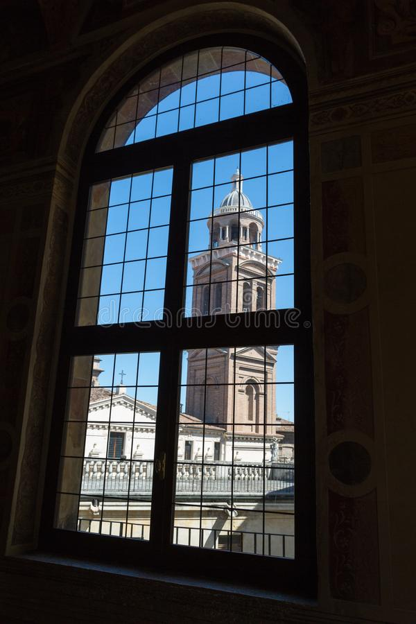Saint Barbara Church Tower: Seen from Window inside Ducal Palace in Mantua -Italy royalty free stock images