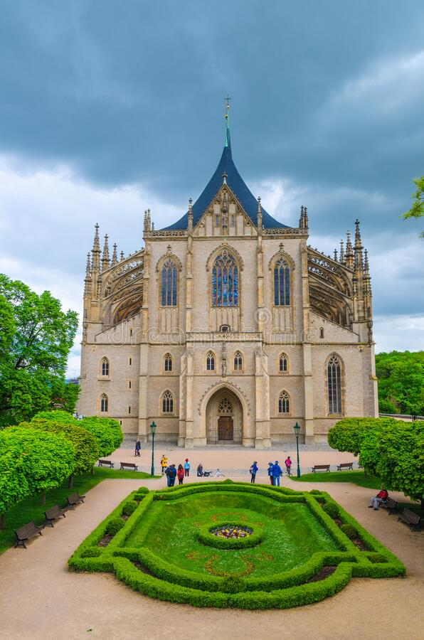 Saint Barbara`s Church Cathedral of St Barbara Roman Catholic church Gothic style. Building facade, flowerbed with bushes in Kutna Hora historical Town Centre stock photos