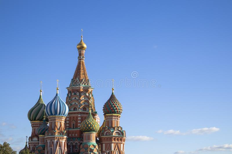 Saint Basilic Cathedral colourful domes on a blue sunny sky royalty free stock image