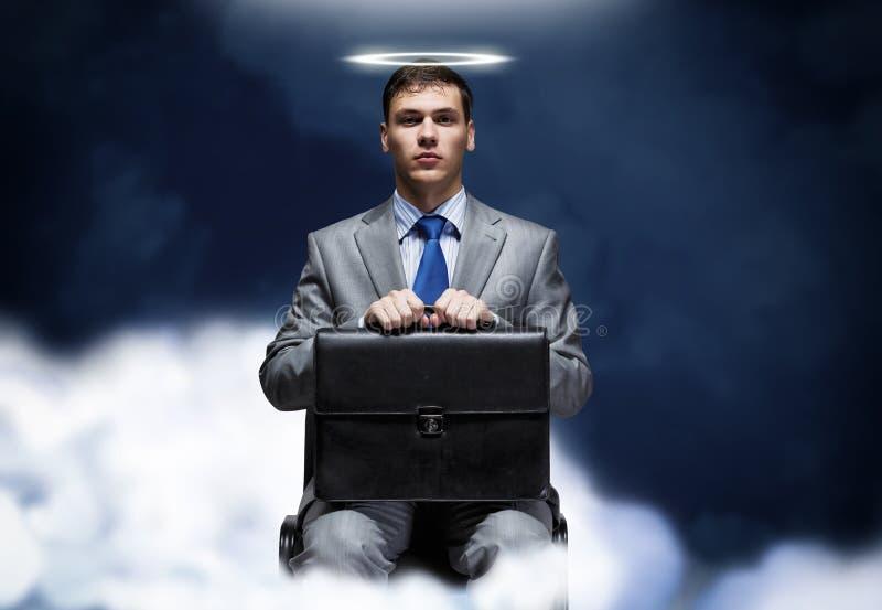 https://thumbs.dreamstime.com/b/saint-businessman-young-halo-above-head-sitting-chair-43771240.jpg