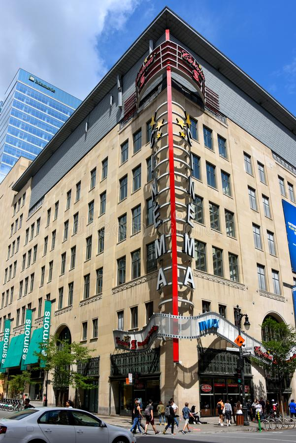 Saint Catherine and Metcalfe in Montreal. Montreal, Canada - August 10, 2019: The Carrefour Industrielle-Alliance building on the busy corner of Saint Catherine royalty free stock image