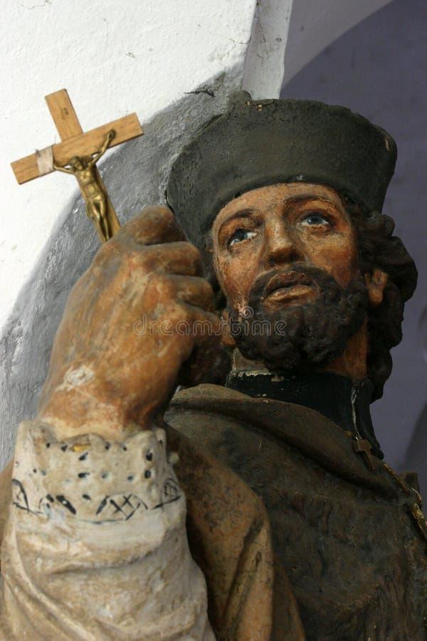 Saint with cross stock photo