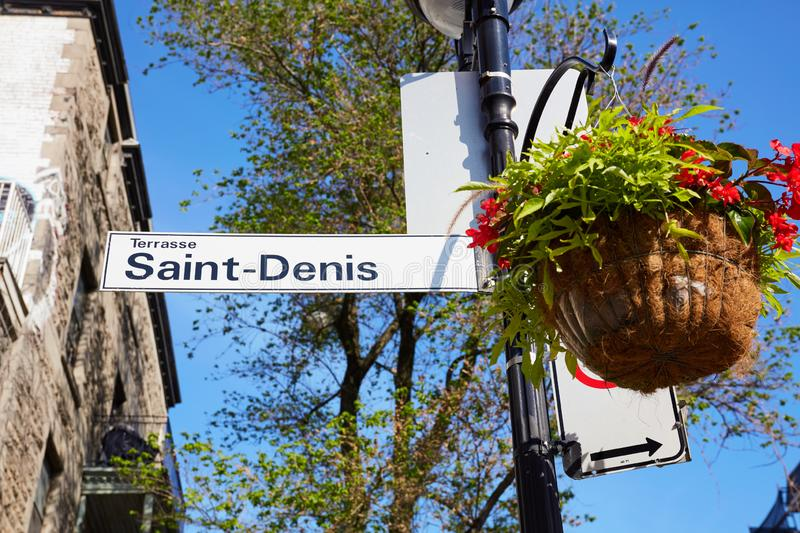 Saint Denis street sign attached to lamp post in Montreal Quebec royalty free stock images