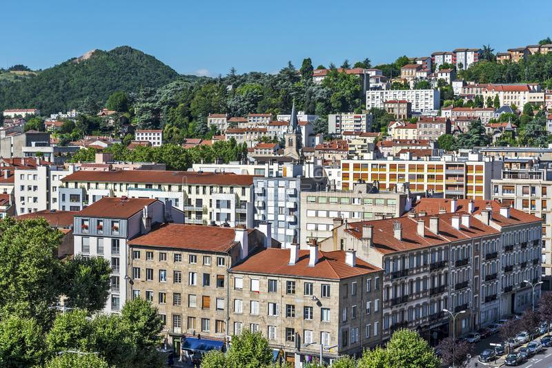 Saint Etienne cityscape as seen from the tower of Cite du Design in western direction. The Montaud hill is at background. Saint-Etienne, France – July 29 stock photos