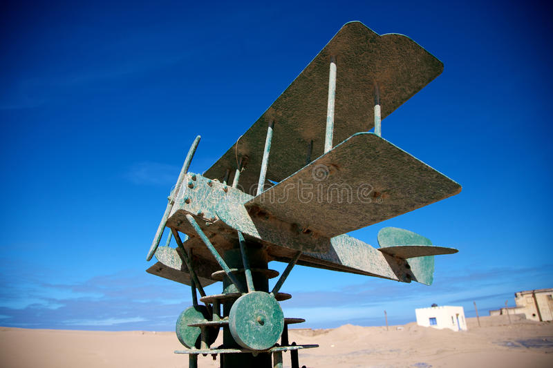 Saint exupery memorial. Green plane on a green brick construction with blue sky, memorial to Saint-Exupery stock photos