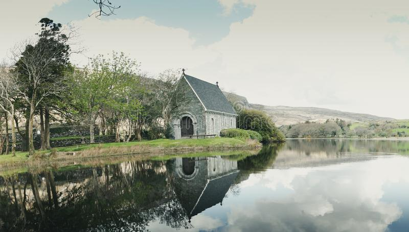 Saint Finbarr`s Oratory, a chapel built on an island in Gougane Barra, a very serene and beautiful place in county Cork. April 30th, 2018, Gougane Barra royalty free stock photos