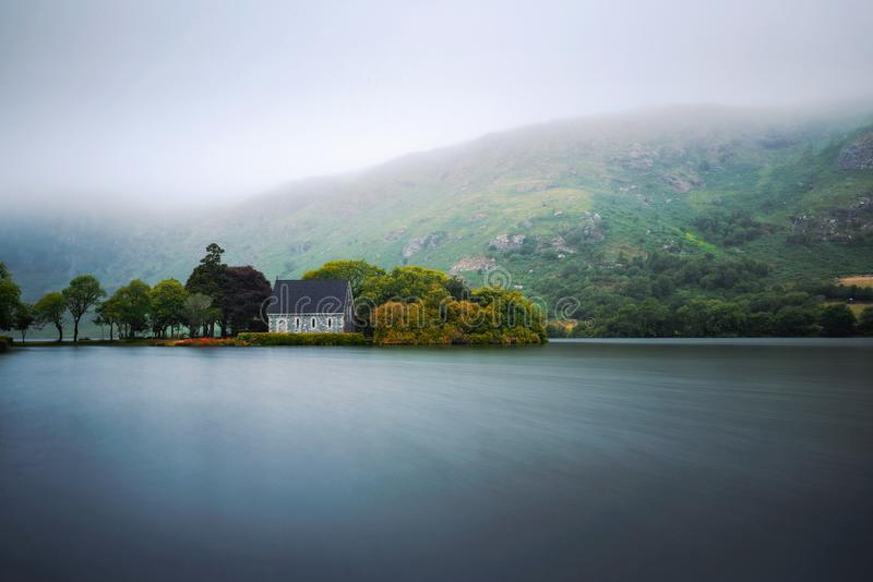 Saint Finbarr`s Oratory chapel in county Cork, Ireland. Built on an island in the Gouganebarra Lake. Long exposure royalty free stock images