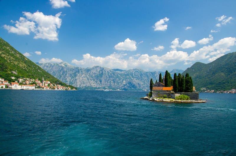 Saint George monastery on island in Boka Kotor bay, Montenegro stock images