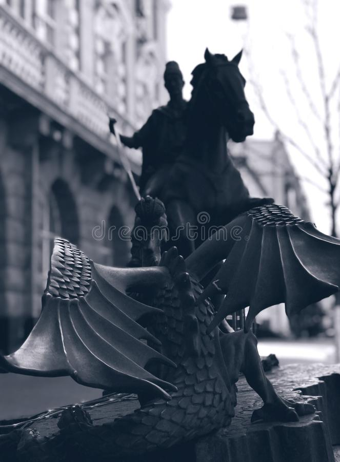 Saint George Slays a Dragon - DRAGON. The legend of Saint George and the Dragon describes the saint taming and slaying a dragon that demanded human sacrifices royalty free stock images