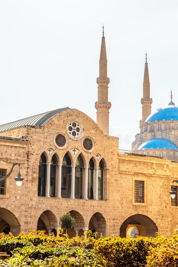 Saint Georges Maronite cathedral and Mohammad Al-Amin Mosque in the background in the center of Beirut, Lebanon. Amine, ancient, arab, arabesque, arabic stock photo