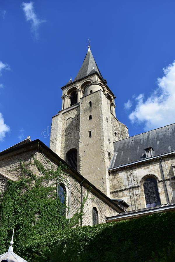 Saint Germain des Pres Abbey, Paris, France. Tower with ivy, sunny day, blue sky. Paris, France. Abbaye Saint Germain des Pres. Tower with ivy and blue sky stock photo