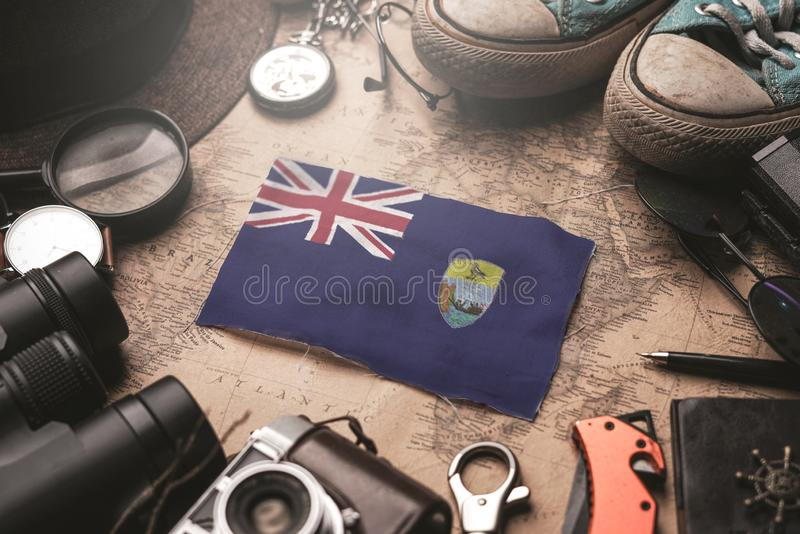 Saint Helena Flag Between Traveler`s Accessories on Old Vintage Map. Tourist Destination Concept.  stock photography