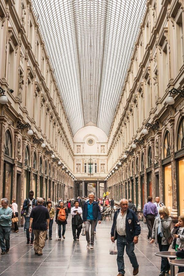 Saint Hubert Gallery. BRUSSELS - SEPTEMBER, 25: People shop in Saint Hubert Gallery in Brussels, famous by its high end shops. September 25, 2013 Brussels stock image