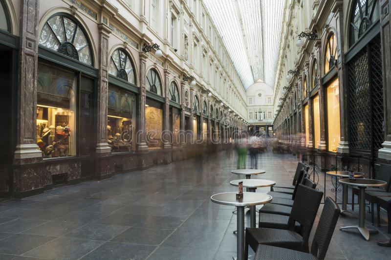 Saint Hubert Royal Galleries in Brussels. The Saint-Hubert royal galleries in Brussels (Galleries de la Reine), with a 200 meters long glass roof at a height of stock photography