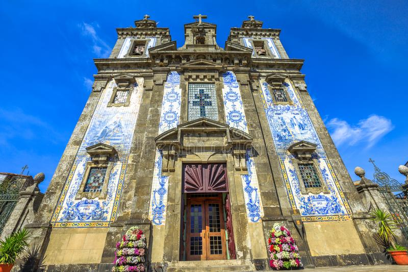 Saint Ildefonso church. The two bell towers and azulejo tiles covering the facade of famous Saint Ildefonso church near Batalha Square in Porto, Portugal. The royalty free stock photos