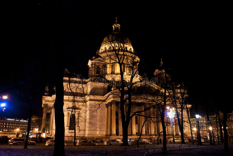Saint Isaac's Cathedral or Isaakievskiy Sobor in Saint Petersburg, Russia. T. In the night under the trees stock images