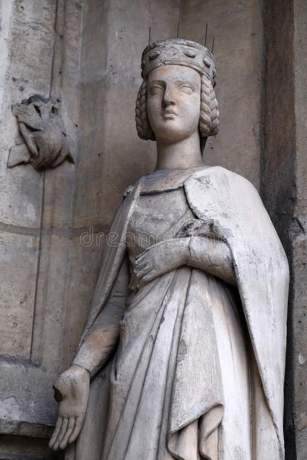 Saint Isabelle of France. Statue on the portal of the Saint Germain l `Auxerrois church in Paris, France stock images