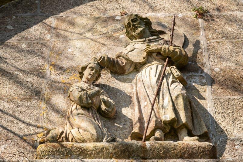 Saint James que bautiza bajorrelieve de la piedra de la escena de la reina de Lupa imagen de archivo