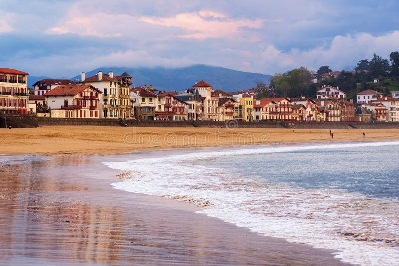 Saint Jean de Luz, Basque Coast, France, on sunset. Traditional basque timber houses facing sand beach in Saint Jean de Luz, a resort town on Atlantic coast, Bay stock images