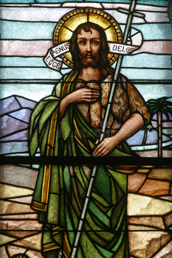 Saint John the Baptist. Stained glass church window royalty free stock photo