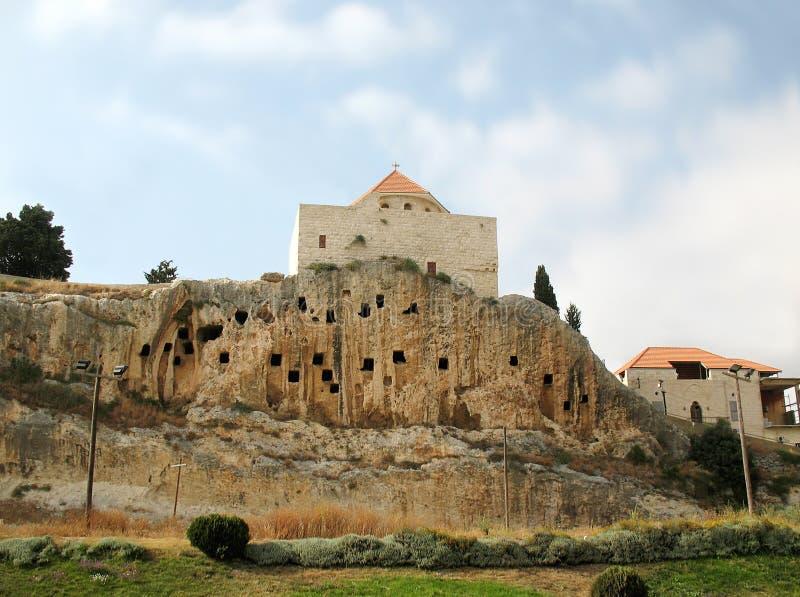Saint John Church of Amioun, Lebanon. The Mar Yuhanna el Sheer (St. John of the cliff) church in the Lebanese town of Amioun, is built on a cliff with man-made stock photos