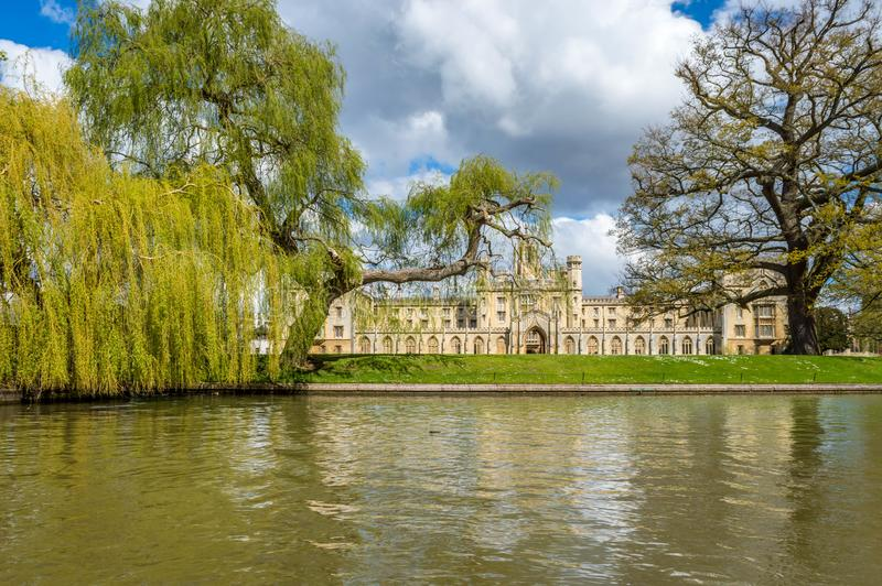 Saint John College on a bright sunny day with patches of clouds over the blue sky, Cambridge, United Kingdom. Saint John College on a bright sunny day with stock image