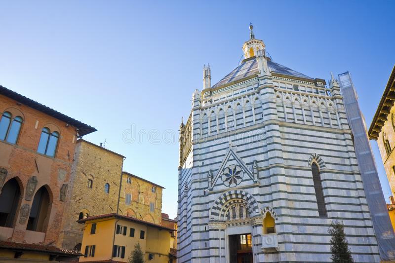 Saint John`s baptistery in Pistoia city built in the year 1303 with an octagonal base - On the left the Episcopal Palace Tuscany royalty free stock photo